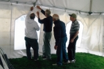 Putting up the tent for the SHS Football Tailgate Party is Chuck Czajkowski, Gordon Kristiansen, George Gomperts & B